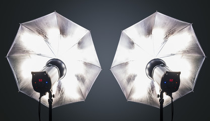 Photo studio strobe flash with umbrellas
