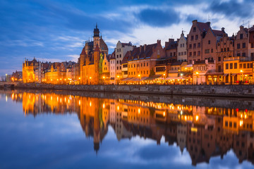 Old town of Gdansk reflected in Motlawa river at dusk, Poland