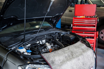 Cars with open hood for servicing