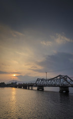 bridge and river at sunset in kampot cambodia