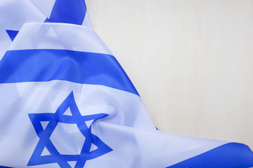 Israeli national flag on a wooden background