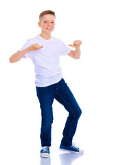 A school boy points to his white T-shirt.