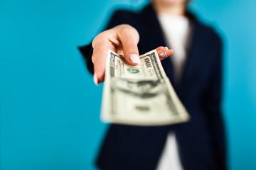 Woman holding a 100 dollar bill