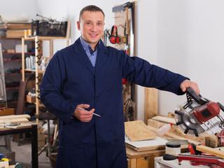 Woodworker posing in workshop