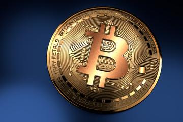 Bitcoin. Pièce de bitcoin dorée gros plan sur fond bleu droite