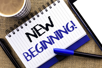 Text sign showing New Beginning Motivational Call. Conceptual photo Fresh Start Changing Form Growth Life written on Notebook Book on the jute background Tablet Coffee Cup and Pens next to it
