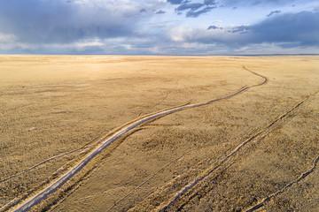 Dirt road winding through prairie in northern Colorado