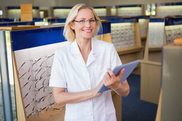 Optician using her tablet pc