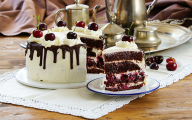 Black forest cake, Schwarzwalder Kirschtorte, Schwarzwald pie, dark chocolate and cherry dessert on wooden background