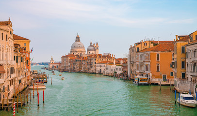 Beautiful view on the Venice with amazing canals, gondolas and cathedrals.