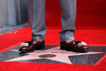 Actor Morgan poses on his star after it was unveiled on the Hollywood Walk of Fame in Los Angeles