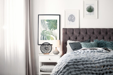 Modern room interior with comfortable bed