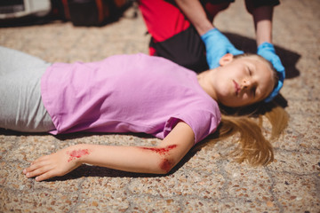 Unconscious girl fallen on ground after accident