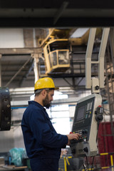 Technician operating machine in metal industry