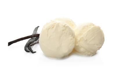 Balls of tasty vanilla ice cream and pods on white background