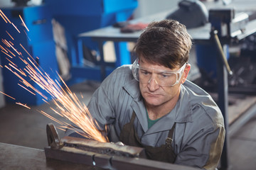Welder working at work shop