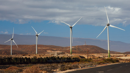 electric wind turbines farm, blue sky background
