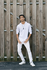 Young Male Model Having Fun in Front of Wooden Wall