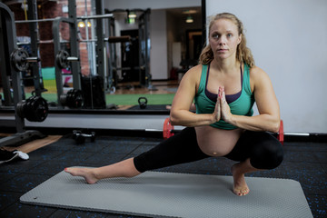 Pregnant woman performing yoga
