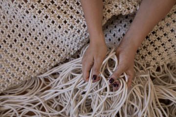 Woman knotting strings