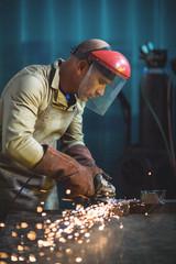 Male welder working on a piece of metal