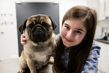 Portrait of girl with her pet dog