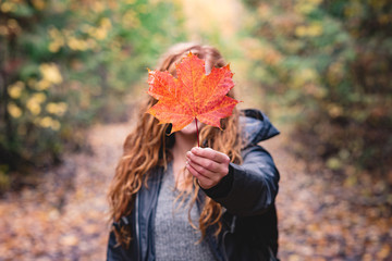 Woman showing maple leaf
