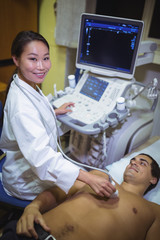 Male patient receiving a ultrasound scan on the chest