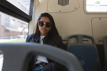 Teenage girl travelling in the bus