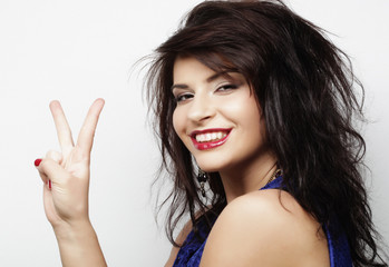 lovely woman showing victory or peace sign over white background