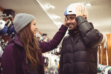 Couple shopping in a helmet shop