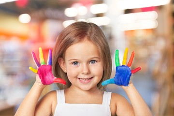 Little girl with hands in colored
