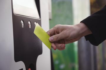 Man using card at electric vehicle charging station