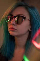 Close up of stylish woman in sunglasses