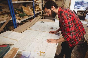 Man looking at blueprint