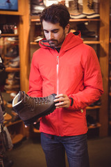 Man selecting shoe in a shop