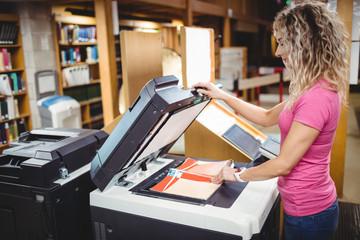 Woman using a copy machine