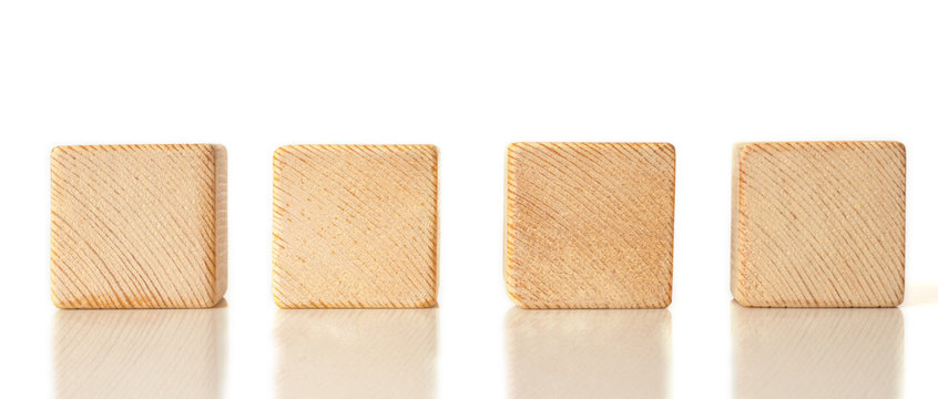 4 wooden cubes on white background