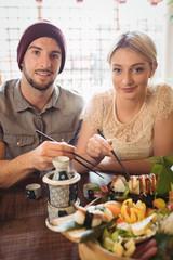 Portrait of couple having sushi