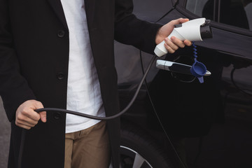 Man holding car charger
