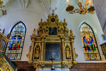 Stained glass windows and the altar of the German Church in Stockholm Sweden