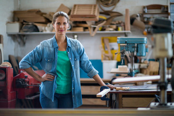 Portrait of female carpenter in workshop