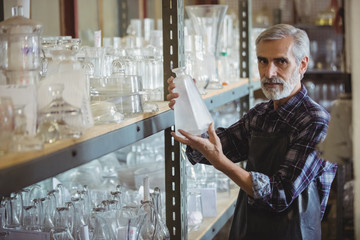 Glassblower examining glassware