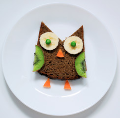 stock-photo-healthy-food-art-for-children-breakfast-funny-owl-from-fruit-on-white-plate-top-view