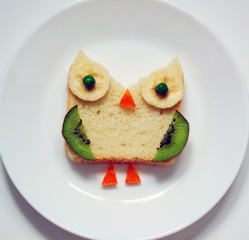 stock-photo-healthy-kids-breakfast-cute- funny-owl-from-fruit-on-white-plate