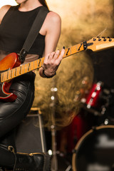 Female guitarist playing on stage