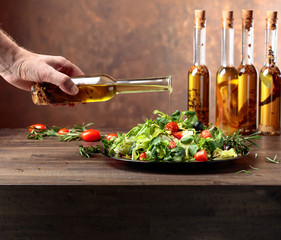 Green salad with olive oil .