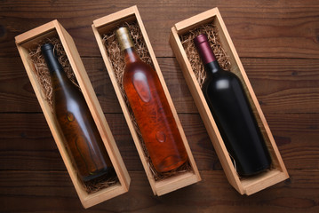 Cabernet and Chardonnay wine bottles in individual cases