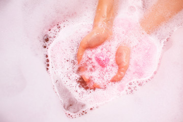 bath salt ball dissolves in the hands. ball of salt dissolves in water. Colored bath bombs