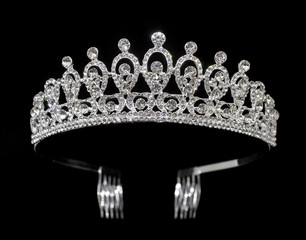Silver tiara diadem with gems and diamonds isolated on black background